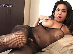 TS Leo playing in a sexy fishnet bodystocking