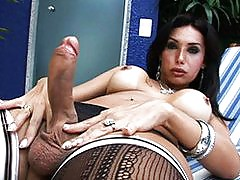 Busty tgirl Isabelli playing with her huge cock