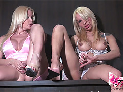 Two blonde trannies cumming on each others tits