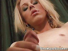 Skinny blondie shemale strokes her juicy cock