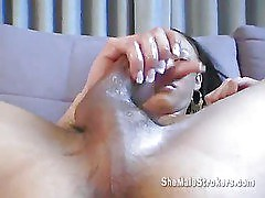 a stunning shemale tasting her cum
