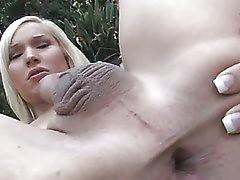a stunning shemale pornstar masturbates outdoors