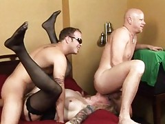 Tattooed shemale beeing banged by 2 hard and aroused cocks
