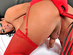 Hot shemale in red latex toys her ass