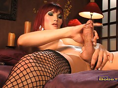 Smoking hot Eva masturbating in sexy fishnets