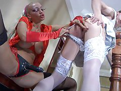 Sexy crossdresser smoothens his nylons ready for a fuck with a strapon diva