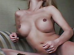 a stunning shemale beauty plays her cock