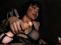 Horny Danielle teasing her slave with a strap-on