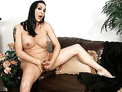Transsexual Kourtney playing with her huge hard cock