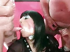 Tgirl slut Zoe takes a load of hot cum on her slutty face in this steamy bukkake party